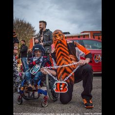 Garey Faulkner poses with Matthew Medina, 8, from Houston, Texas who has the condition osteogenesis imperfecta. Faulkner, who holds local fundraisers and charity events in Cincinnati, raised money for Matthew and his parents to fly to Cincinnati to fulfill Matthew's dream to visit every NFL stadium in the country, Monday Nov. 16, 2015. Photo credit: Madison Schmidt for The Enquirer.