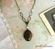 Oval Locket necklace in Antique bronze with Moroccan patterns ivory crystals and unusual handmade chain Two pictures keepsake vintage style by LeBijouAntique on Etsy https://www.etsy.com/listing/247684072/oval-locket-necklace-in-antique-bronze