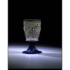 Goblet. Made Venice, 1475-1510.Coulourless and clear blue glass, blown in a dip-mould and tooled, gilt and enamelled. V & A Musuem