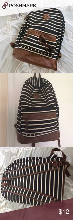✨ Mossimo Backpack w 3 pockets ✨ Blue and white striped backpack with leather bottom and zippers. Large zipper pocket has 2 inside pockets, plus two smaller zipper pockets on the front. I used this backpack for everything from going to class to traveling to taking to the beach! Small stains are pictured. Price is negotiable! Mossimo Supply Co. Bags Backpacks