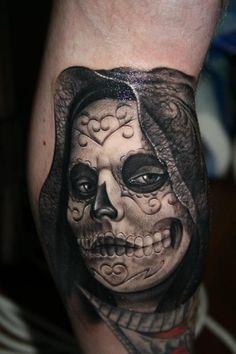 Dark creepy day of the dead tattoo