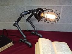 whimsical steampunk/industrial lamp with almost bird-like automaton features ~ eBay