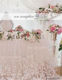 Tulle and Chiffon table skirt is adorned with cascading petals Tulle Tablecloth, Tulle Table Skirt, Table Skirts, Wedding Table, Diy Wedding, Wedding Gifts, Wedding Hall Decorations, Baby Shower Decorations, Quinceanera Decorations