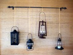 I hung my lantern collection from a curtain rod! I love the results! :: Hometalk