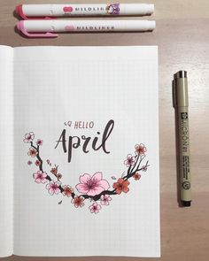 Bullet journal monthly cover page, April cover page, cherry blossom drawing, hand lettering. | @charmingjournals