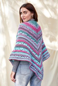 FREE KNITTING PATTERN! What better way to keep warm during chilly spring days and evenings than with a colorful shawl?! Self-shading and striping Major is the perfect yarn for this fun, top-down shawl. Lace motifs are easily memorized in this quick, two skein project! Knitting Patterns Free, Knit Patterns, Free Knitting, Free Pattern, Knitting Stitches, Linen Stitch, Spring Starts, Universal Yarn, Crochet Poncho