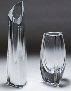 Lot 305: Baccarat Crystal Vases; Two vases marked near the bases and having abstract forms