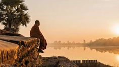 Cambodian monk sitting in front of Angkor Wat temple. #travel #cambodia #angkor wat