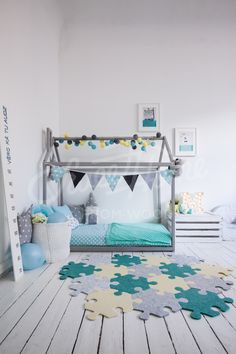 Mint and grey kids room interior idea with puzle rug, carpet, toddler bed, house shaped bed, nursery wood house bed bed home Montessori toy frame bed original bed home bed floor bed developing toy