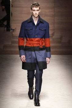Salvatore ferragamo also uses stripe patterns, but their design and colours are younger looking than louis vuitton. The trench coat is not typical design, but it includes several pockets. Furthermore, some complementary colours make looking more youthful and active feeling.    Salvatore Ferragamo | Fall 2014 Menswear Collection | Milan