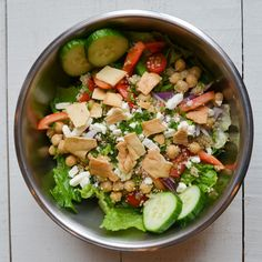 Santorini: Chopped Romaine, Crumbled Feta, Quinoa, Chickpeas, Red Peppers, Grape Tomatoes, Red Onion, Cucumbers, Parsley, Pita Chips with Lemon Juice and Olive Oil