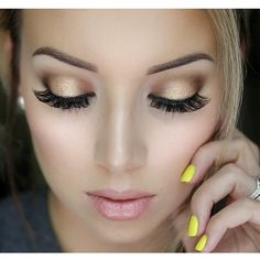 Love everything about this! The bright yellow nails, the shimmery pink lips,and the goldish/bronze-ish eyes.