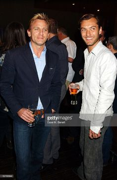 Actors Daniel Craig (L) and Jude Law attend the screening of 'The Jacket' at the Rex Cinema and bar on May 9, 2005 in London, England.