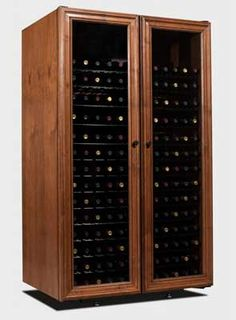Vinotheque Villa Series Venetian 330 Wine Cabinet. Starting at: $3,835.00. Made in the US and with a self contained cooling unit. Find it and more at WineRacks.com