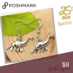 Novelty Dinosaur earrings  Silver, NWT, very cute!  Funny too lol - quite a novelty and hard to find! Jewelry Earrings