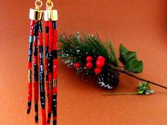 Long tassel earrings  Christmas jewelry  Seed di Frammentidivetro