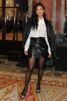 Glamorous: Nicole Scherzinger ensured all eyes would be on her as she settled into the front row at the Redemption show during Paris Fashion Week on Friday Pantyhose Outfits, Nylons, Pantyhose Heels, Black Leather Mini Skirt, Leather Skirt, Leather Socks, Jeans Petite, Polka Dot Tights, Fashion Tights