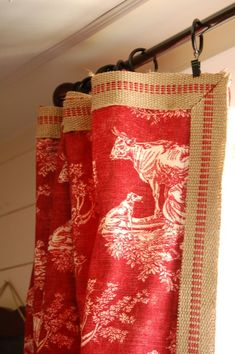 the whole curtain! These curtains channel that vintage grainsack look that's so on trend these days. The large-scale pattern and reverse colorway (white on red) makes this toile a standout.