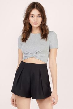 The Knotted Up Crop Tee is not your basic crop top. This classic piece is made from a stretchy knit fabric and features a cool knot detail at the front. We love it with a high waisted midi skirt and chunky wedges.  Get 50% off your order when you join Tobi.com