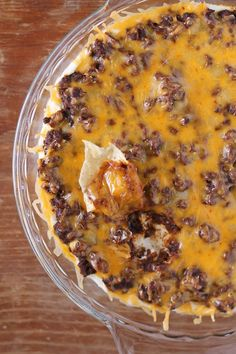 This meaty, creamy, lightened up Chili Cheese Dip with cream cheese is perfect football food! Only 116 calories or 3 Weight Watchers points. www.emilybites.com