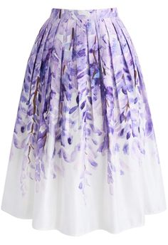 Have a fit of wisteria with this crazy-fabulous printed midi skirt. The lilac-hued flowers hang from the top of the skirt and fade away into a crisp, white hemline curated by elegant pleats.