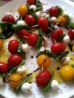 Quick, easy & healthy go to appetizer. Cherry Tomato, Basil, & Mozzarella Ball on toothpick. Drizzle w/olive oil & balsamic.