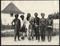 Group of Moro men Photo by Burr McIntosh