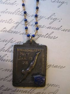 vintage recycled repurposed 1928 YMCA vintage swim medal on gold filled wire wrapped lapis necklace