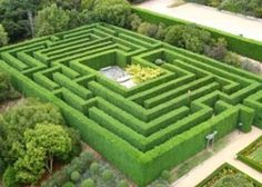 I think it would be cool to have a small garden maze (much smaller than this) that leads to a hidden pond/reading area.