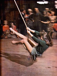 1963, Girl at party uses rope swing