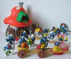 Smurfs..I still have a few of the stuffed ones out in the garage.,,oh my