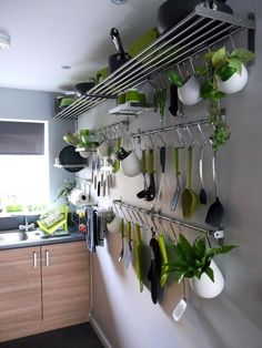 Cool Kitchen Storage / Organization Love for the wall opposite the cabinet bank!