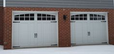 Two 9x7 Model 5632A Carriage style overlay garage doors with Arched Stockton top glass installed by the Richmond store.