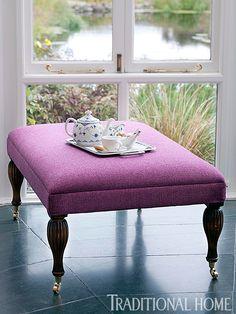 """Well-suited in magenta """"Featherweight"""" tweed from Carloway Mill, the """"Velvets"""" bench from Mulberry through GP & J Baker is chic. - Traditional Home ® / Photo: Dominic Blackmore"""
