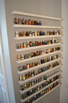 Very cool!!! However, it would probably be easier and safer for the wall to create the shelving as one piece vs individual shelves as it appears here.