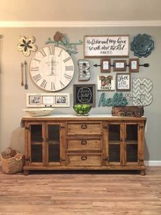 Lots of things going on here but my eye was first drawn to the oversize wooden clock. The decorator has done an excellent job of creating a unifying balance by bringing together a pair of name initials made of varied materials. Here we see a new color introduction in a light pastel blue combined with earthy wood tones and distressed white. When you combine this with several family photos and some family themed signs you will create a timeless rustic wall arrangement that begs the viewers…
