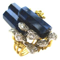 """A Surrealist gold lapis and diamond ring. The 1 1/2' x 1"""" 18k yellow gold ring with amoeba shaped pave diamond plaques,octagonal shaped lapis lazuli columns and fern-like gold accents. This ring is amazing on. A wonderful piece of fantasy. Circa 1960s"""