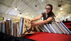 Betsy Jaszczak sorts and organizes books in Adelbert gym for CWRU's big book sale in Cleveland. More than 70,000 are being taken out of boxes and arranged on the tables. The sale goes on from May 31 to June 3. (Joshua Gunter/ The Plain Dealer)