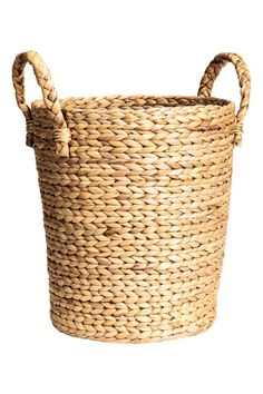 Large storage basket: Large, sturdy storage basket in braided water hyacinth with two handles at the top. Height 36 cm, diameter at the top 30 cm.