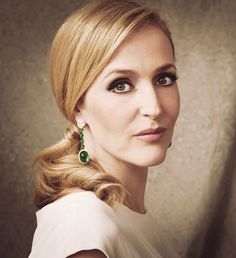 Gillian Anderson. I want the shiny hair and those earrings, please!!