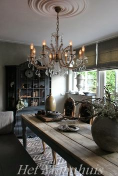 rustic table  and chandelier (maybe middle-eastern though...