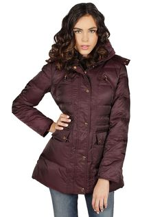 Kenneth Cole® New York Puffer Jacket in Concord A puffer jacket that has the perfect balance of puff and style. The rich Concord purple hue is glammed up with golden hardware and faux fur. Additional snap buttons are placed by the zipper for a secure fit and to add more pop with the golden tones. The hood is completely removable for your customization needs and plenty of storage with snap pockets and zip chest pockets.