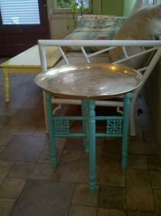 My Moroccan tray table polished up with Brasso and repainted in aqua. Paint: Martha Stewart Araucana Teal. I originally paid 25.00 for it. by diane.smith