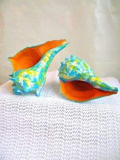 Hand painted conch shells via Etsy.