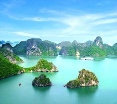 Ha Long Bay, Vietnam  The bus trip to and from Hanoi was good because it gave us a chance to see the Vietnamese countryside. And coming from a western country, the sight of hundreds of people working the rice fields in their rice hats, barefooted, with their water buffalos, is fantastic.  Ha Long Bay is very beautiful. Thousands of huge limestones rise out of the sea, ghost-like against the sun.