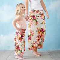 Share a sense of style with your little fashionista in mommy-and-me apparel! This collection of made in the USA maxi skirts features festive prints that pair perfectly with your princess' playful personality, while stretch fabric lends a fluid fit for Mom. Whether worn to a family photo session or just for fun, these pretty picks will inspire similes no matter the scenario.