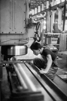 At Wuhan's heavy-tooling factory, one of its four thousand workers runs a milling machine. Here, 80 percent of the machinery is Chinese-made, 20 percent Czech or East German. Construction of the factory started in 1956 and will be finished in 1959