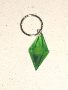 HAHA @Jenny Boyd we need these/we need to play Sims!!     Sims Plumbob Diamond Thing Keychain by TheMagesEmporium on Etsy, $4.50