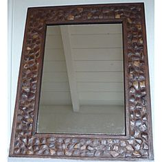 @Overstock - This full-size all natural coconut shell mirror is sure to make a statement in any room of your home. The handcrafted mirror can be hung vertically or horizontally.http://www.overstock.com/Worldstock-Fair-Trade/Large-Coconut-Shell-Wall-Mirror-Thailand/4422150/product.html?CID=214117 $88.99