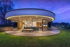 Round modern villa design by 123 DV Architects